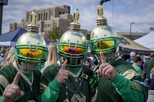 Sep 29, 2018; South Bend, IN, USA; From left to right: Bill Menegay of Denison, Iowa, Matt Menegay of Ankenny, Iowa, and Matt Schwenn of Cedar Rapids, Iowa pose for a photo outside Notre Dame Stadium before the game between the Notre Dame Fighting Irish and the Stanford Cardinal. Mandatory Credit: Matt Cashore-USA TODAY Sports