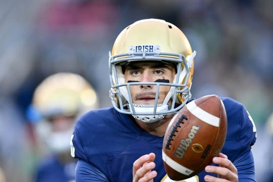 Sep 29, 2018; South Bend, IN, USA; Notre Dame Fighting Irish quarterback Ian Book (12) warms up before the game against the Stanford Cardinal at Notre Dame Stadium. Mandatory Credit: Matt Cashore-USA TODAY Sports