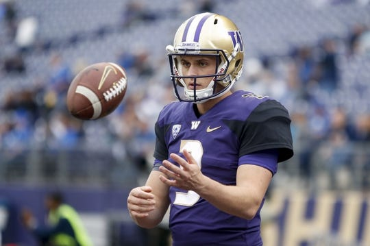 Sep 29, 2018; Seattle, WA, USA; Washington Huskies quarterback Jake Browning (3) tosses a ball during pre-game warm-ups before the start of a game against the Brigham Young Cougars at Husky Stadium. Mandatory Credit: Jennifer Buchanan-USA TODAY Sports