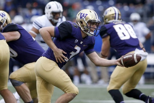 Sep 29, 2018; Seattle, WA, USA; Washington Huskies quarterback Jake Browning (3) hands the ball off against the Brigham Young Cougars during the first quarter at Husky Stadium. Mandatory Credit: Jennifer Buchanan-USA TODAY Sports