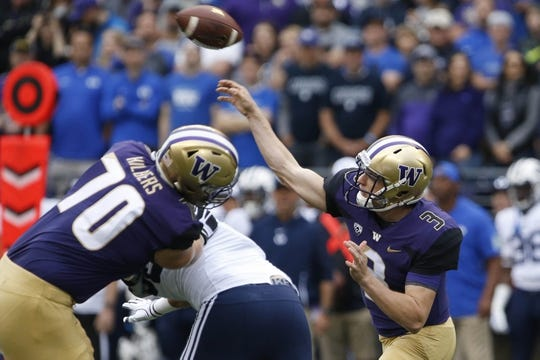 Sep 29, 2018; Seattle, WA, USA; Washington Huskies quarterback Jake Browning (3) throws a pass against the Brigham Young Cougars during the first quarter at Husky Stadium. Mandatory Credit: Jennifer Buchanan-USA TODAY Sports