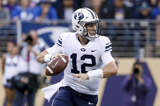Sep 29, 2018; Seattle, WA, USA; Brigham Young Cougars quarterback Tanner Mangum (12) drops back to pass against the Washington Huskies during the first quarter at Husky Stadium. Mandatory Credit: Jennifer Buchanan-USA TODAY Sports