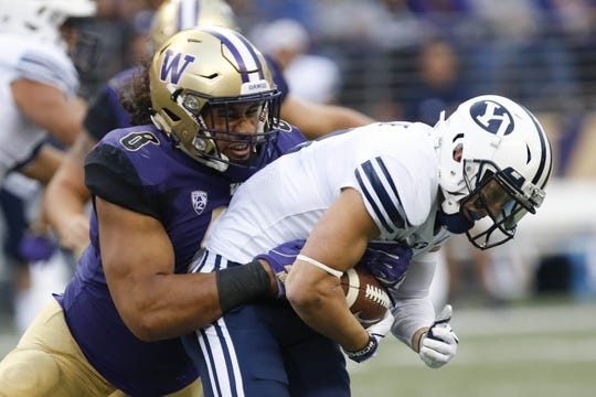 Sep 29, 2018; Seattle, WA, USA; Washington Huskies linebacker Benning Potoa'e (8) tackles Brigham Young Cougars wide receiver Dylan Collie (3) for a loss during the first quarter at Husky Stadium. Mandatory Credit: Jennifer Buchanan-USA TODAY Sports