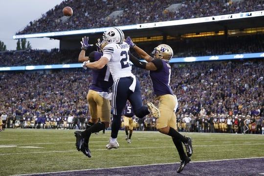 Sep 29, 2018; Seattle, WA, USA; Washington Huskies defensive backs Byron Murphy (left) and Brandon McKinney (right) break up a pass in the end zone intended for Brigham Young Cougars wide receiver Talon Shumway (21) during the second quarter at Husky Stadium. Mandatory Credit: Jennifer Buchanan-USA TODAY Sports