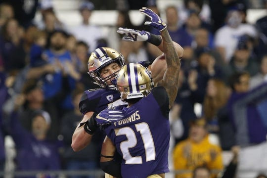 Sep 29, 2018; Seattle, WA, USA; Washington Huskies tight end Drew Sample (88) celebrates his touchdown with wide receiver Quinten Pounds (21) against the Brigham Young Cougars during the third quarter at Husky Stadium. Mandatory Credit: Jennifer Buchanan-USA TODAY Sports