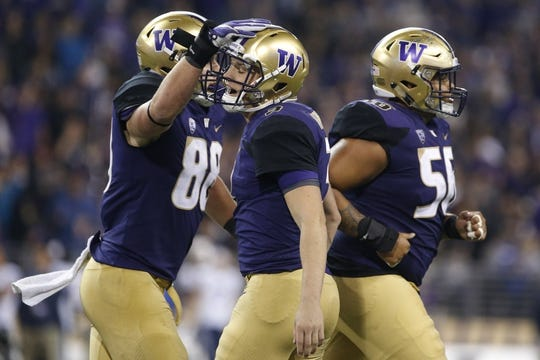Sep 29, 2018; Seattle, WA, USA; Washington Huskies tight end Drew Sample (88) pats quarterback Jake Browning (3) on the head after Browning threw a 15-yard touchdown pass to Sample against the Brigham Young Cougars during the third quarter at Husky Stadium. Mandatory Credit: Jennifer Buchanan-USA TODAY Sports