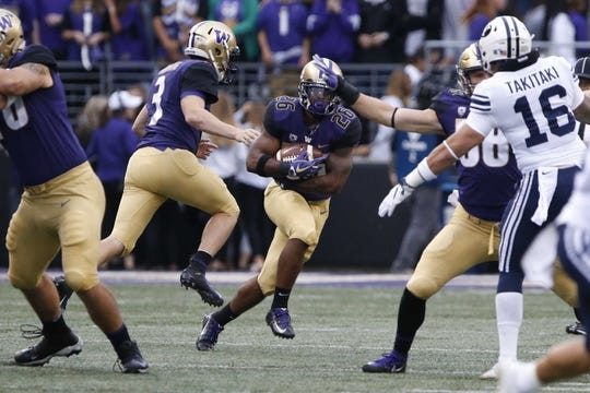 Sep 29, 2018; Seattle, WA, USA; Washington Huskies running back Salvon Ahmed (26) rushes the ball against the Brigham Young Cougars during the first quarter at Husky Stadium. Mandatory Credit: Jennifer Buchanan-USA TODAY Sports