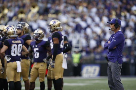 Sep 29, 2018; Seattle, WA, USA; Washington Huskies head coach Chris Petersen looks on from the sidelines during the first quarter against the Brigham Young Cougars at Husky Stadium. Mandatory Credit: Jennifer Buchanan-USA TODAY Sports