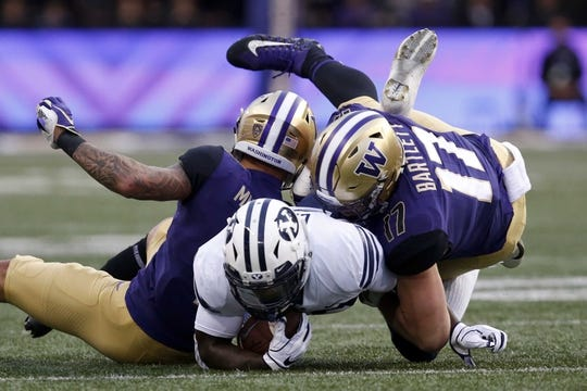 Sep 29, 2018; Seattle, WA, USA; Washington Huskies defensive back Byron Murphy (left) and linebacker Tevis Bartlett (right) combine to tackle Brigham Young Cougars running back Squally Canada (22) during the first quarter at Husky Stadium. Mandatory Credit: Jennifer Buchanan-USA TODAY Sports