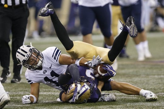 Sep 29, 2018; Seattle, WA, USA; Washington Huskies wide receiver Aaron Fuller (2) gets tackled by Brigham Young Cougars defensive back Austin Lee (11) during the third quarter at Husky Stadium. Mandatory Credit: Jennifer Buchanan-USA TODAY Sports