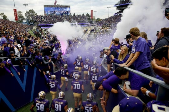 Sep 29, 2018; Seattle, WA, USA; The Washington Huskies take the field before the start of a game against the Brigham Young Cougars at Husky Stadium. Mandatory Credit: Jennifer Buchanan-USA TODAY Sports