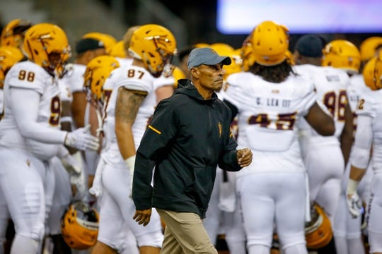 Sep 22, 2018; Seattle, WA, USA; Arizona State Sun Devils head coach Herm Edwards walks back to the locker room before the start of a game against the Washington Huskies at Husky Stadium. Mandatory Credit: Jennifer Buchanan-USA TODAY Sports