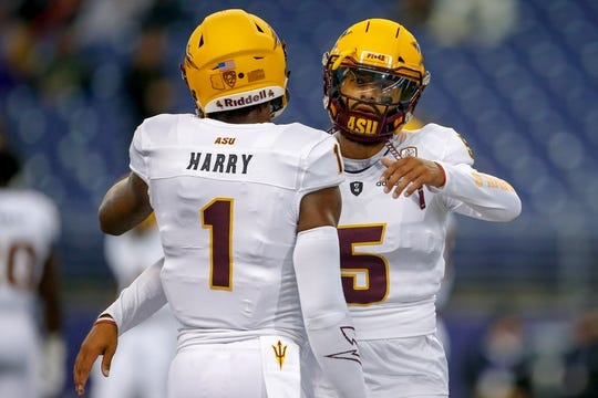 Sep 22, 2018; Seattle, WA, USA; Arizona State Sun Devils wide receiver N'Keal Harry (1) and quarterback Manny Wilkins (5) hug before the start of a game against the Washington Huskies at Husky Stadium. Mandatory Credit: Jennifer Buchanan-USA TODAY Sports
