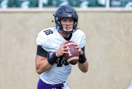 Oct 6, 2018; East Lansing, MI, USA; Northwestern Wildcats quarterback Clayton Thorson (18) warms up prior to a game against the Michigan State Spartans at Spartan Stadium. Mandatory Credit: Mike Carter-USA TODAY Sports