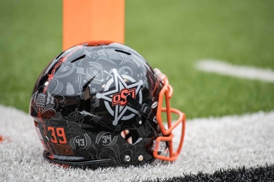 Oct 6, 2018; Stillwater, OK, USA; Oklahoma State Cowboys helmet sits on the sidelines before a game against the Iowa State Cyclones at Boone Pickens Stadium. Mandatory Credit: Rob Ferguson-USA TODAY Sports