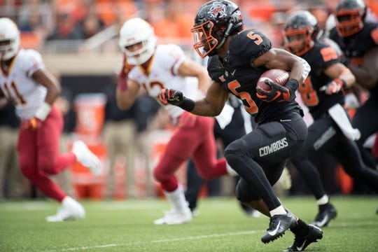 Oct 6, 2018; Stillwater, OK, USA; Oklahoma State Cowboys running back Justice Hill (5) runs the ball against the Iowa State Cyclones during the first quarter at Boone Pickens Stadium. Mandatory Credit: Rob Ferguson-USA TODAY Sports