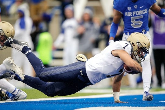 Oct 6, 2018; Colorado Springs, CO, USA; Navy Midshipmen quarterback Garret Lewis (7) dives for a touchdown against the Air Force Falcons in the second quarter at Falcon Stadium. Mandatory Credit: Isaiah J. Downing-USA TODAY Sports