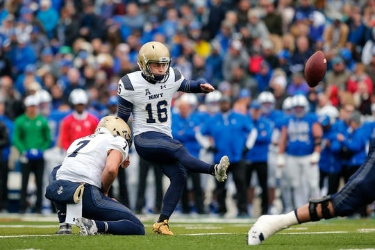 Oct 6, 2018; Colorado Springs, CO, USA; Navy Midshipmen quarterback Garret Lewis (7) holds the ball as place kicker Bennett Moehring (16) kicks for an extra point against the Air Force Falcons in the second quarter at Falcon Stadium. Mandatory Credit: Isaiah J. Downing-USA TODAY Sports