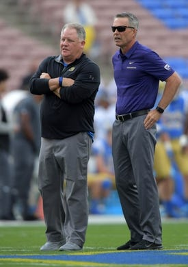 Oct 6, 2018; Pasadena, CA, USA; UCLA Bruins head coach Chip Kelly (left) talks with Washington Huskies head coach Chris Petersen before the game at Rose Bowl. Mandatory Credit: Kirby Lee-USA TODAY Sports