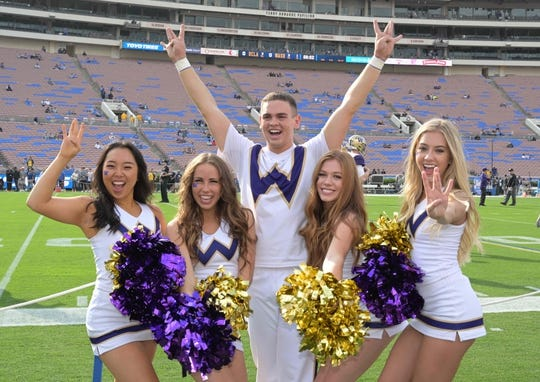 Oct 6, 2018; Pasadena, CA, USA; Washington Huskies cheerleaders pose before the game against the UCLA Bruins at Rose Bowl. Mandatory Credit: Kirby Lee-USA TODAY Sports