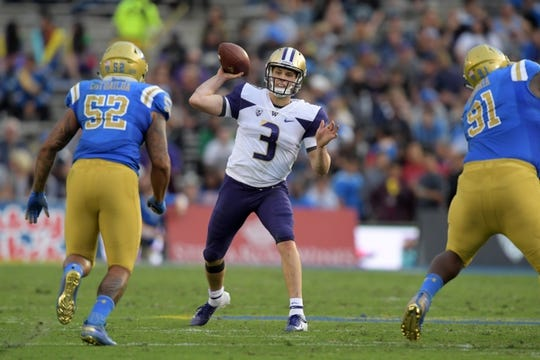 Oct 6, 2018; Pasadena, CA, USA; Washington Huskies quarterback Jake Browning (3) throws a pass under pressure from UCLA Bruins linebacker Lokeni Toailoa (52) and defensive lineman Otito Ogbonnia (91) in the second quarter at Rose Bowl. Mandatory Credit: Kirby Lee-USA TODAY Sports