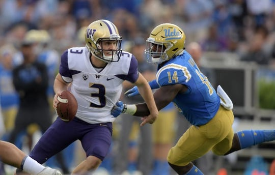 Oct 6, 2018; Pasadena, CA, USA; Washington Huskies quarterback Jake Browning (3) is pressured by UCLA Bruins linebacker Krys Barnes (14) in the second quarter at Rose Bowl. Mandatory Credit: Kirby Lee-USA TODAY Sports