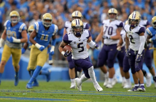 Oct 6, 2018; Pasadena, CA, USA; Washington Huskies wide receiver Andre Baccellia (5) carries the ball on a 21 yard reception in the first quarter against the UCLA Bruins at Rose Bowl. Mandatory Credit: Kirby Lee-USA TODAY Sports