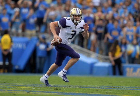 Oct 6, 2018; Pasadena, CA, USA; Washington Huskies quarterback Jake Browning (3) runs with the ball in the first quarter against the UCLA Bruins at Rose Bowl. Mandatory Credit: Kirby Lee-USA TODAY Sports