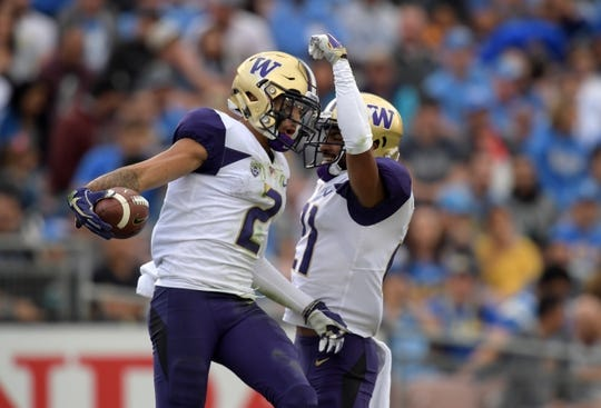 Oct 6, 2018; Pasadena, CA, USA; Washington Huskies wide receiver Aaron Fuller (2) celebrates with wide receiver Quinten Pounds (21) after catching a 25 yard touchdown pass in the first quarter against the UCLA Bruins at Rose Bowl. Mandatory Credit: Kirby Lee-USA TODAY Sports