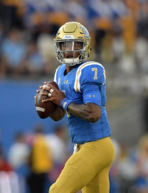 Oct 6, 2018; Pasadena, CA, USA; UCLA Bruins quarterback Dorian Thompson-Robinson (7) throws a pass against the UCLA Bruins in the second quarter at Rose Bowl. Mandatory Credit: Kirby Lee-USA TODAY Sports