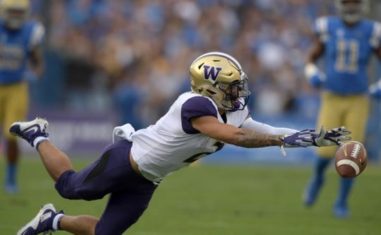 Oct 6, 2018; Pasadena, CA, USA; Washington Huskies wide receiver Aaron Fuller (2) attempts to catch a pass in the first quarter against the UCLA Bruins at Rose Bowl. Mandatory Credit: Kirby Lee-USA TODAY Sports