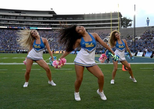 Oct 6, 2018; Pasadena, CA, USA; UCLA Bruins cheerleaders perform during the game against the Washington Huskies at Rose Bowl. Mandatory Credit: Kirby Lee-USA TODAY Sports