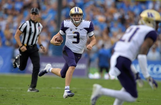 Oct 6, 2018; Pasadena, CA, USA; Washington Huskies quarterback Jake Browning (3) carries the ball in the first half  against the UCLA Bruins  at Rose Bowl. Washington defeated UCLA 31-24. Mandatory Credit: Kirby Lee-USA TODAY Sports