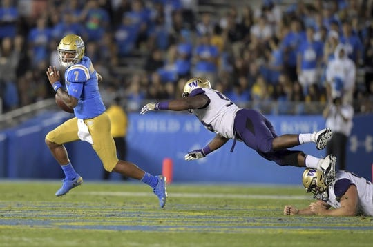 Oct 6, 2018; Pasadena, CA, USA; UCLA Bruins quarterback Wilton Speight (3) is pursued by Washington Huskies defensive lineman Levi Onwuzurike (95) in the third quarter at Rose Bowl. Washington defeated UCLA 31-24. Mandatory Credit: Kirby Lee-USA TODAY Sports