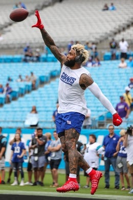 Oct 7, 2018; Charlotte, NC, USA; New York Giants wide receiver Odell Beckham (13) makes a one handed catch during pre game warm ups before a game against the Carolina Panthers at Bank of America Stadium. Mandatory Credit: Jim Dedmon-USA TODAY Sports