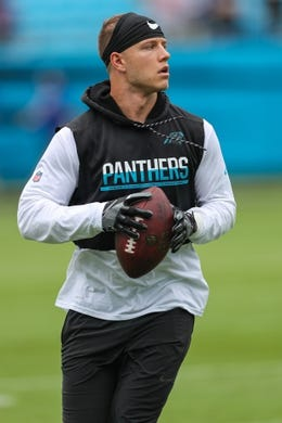 Oct 7, 2018; Charlotte, NC, USA; Carolina Panthers running back Christian McCaffrey (22) runs the ball during pre game warm ups before a game against the New York Giants at Bank of America Stadium. Mandatory Credit: Jim Dedmon-USA TODAY Sports