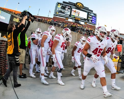 Sep 22, 2018; Iowa City, IA, USA; Wisconsin Badgers fullback Alec Ingold (45) and teammates head onto the field before the game against the Iowa Hawkeyes at Kinnick Stadium. Mandatory Credit: Jeffrey Becker-USA TODAY Sports