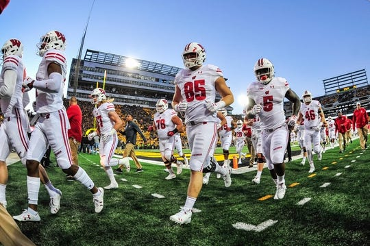 Sep 22, 2018; Iowa City, IA, USA; Wisconsin Badgers tight end Zander Neuville (85) and teammates head off the field before the game against the Iowa Hawkeyes at Kinnick Stadium. Mandatory Credit: Jeffrey Becker-USA TODAY Sports
