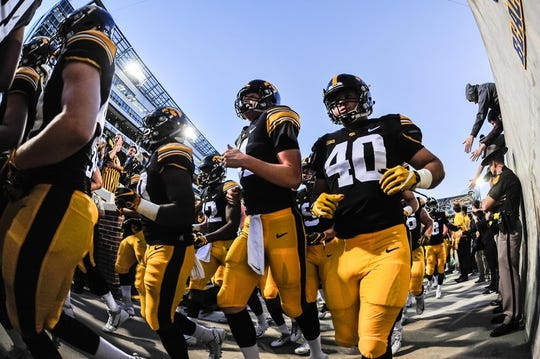 Sep 22, 2018; Iowa City, IA, USA; Iowa Hawkeyes defensive end Parker Hesse (40) and teammates head off the field before the game against the Wisconsin Badgers at Kinnick Stadium. Mandatory Credit: Jeffrey Becker-USA TODAY Sports