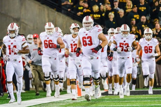 Sep 22, 2018; Iowa City, IA, USA; Wisconsin Badgers offensive lineman Michael Deiter (63) and teammates enter the field before the game against the Iowa Hawkeyes at Kinnick Stadium. Mandatory Credit: Jeffrey Becker-USA TODAY Sports