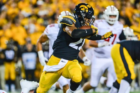 Sep 22, 2018; Iowa City, IA, USA; Iowa Hawkeyes running back Ivory Kelly-Martin (21) runs the ball against the Wisconsin Badgers at Kinnick Stadium. Mandatory Credit: Jeffrey Becker-USA TODAY Sports