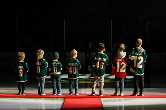 Oct 6, 2018; Saint Paul, MN, USA; The children of Minnesota Wild forward Mikko Koivu (9), forward Zach Parise (11), goalie Devan Dubnyk (40), defenseman Jared Spurgeon (46), and forward Eric Staal (12) pour water on the ice before the game against Las Vegas Golden Knights at Xcel Energy Center. Mandatory Credit: Brad Rempel-USA TODAY Sports