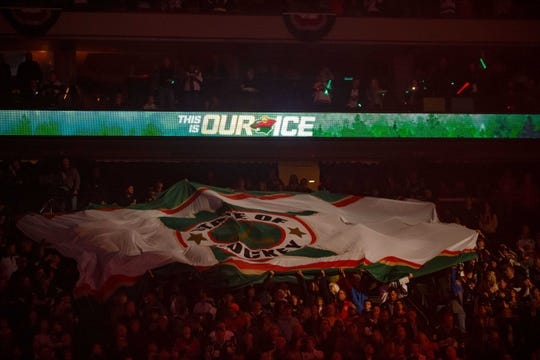 Oct 6, 2018; Saint Paul, MN, USA; Fans wave a flag before the game between the Minnesota Wild and Las Vegas Golden Knights at Xcel Energy Center. Mandatory Credit: Brad Rempel-USA TODAY Sports