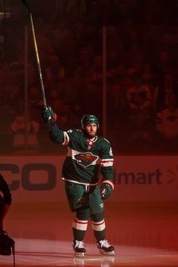 Oct 6, 2018; Saint Paul, MN, USA; Minnesota Wild forward Jason Zucker (16) is introduced before the game against Las Vegas Golden Knights at Xcel Energy Center. Mandatory Credit: Brad Rempel-USA TODAY Sports