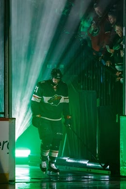 Oct 6, 2018; Saint Paul, MN, USA; Minnesota Wild forward Eric Fehr (21) is introduced before the game against Las Vegas Golden Knights at Xcel Energy Center. Mandatory Credit: Brad Rempel-USA TODAY Sports