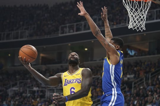 October 12, 2018; San Jose, CA, USA; Los Angeles Lakers guard Lance Stephenson (6) shoots the basketball against Golden State Warriors forward Alfonzo McKinnie (28) during the first quarter at SAP Center. Mandatory Credit: Kyle Terada-USA TODAY Sports