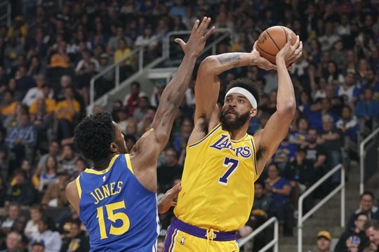 October 12, 2018; San Jose, CA, USA; Los Angeles Lakers center JaVale McGee (7) shoots the basketball against Golden State Warriors center Damian Jones (15) during the first quarter at SAP Center. Mandatory Credit: Kyle Terada-USA TODAY Sports