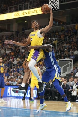 October 12, 2018; San Jose, CA, USA; Los Angeles Lakers forward Johnathan Williams (19) is fouled by Golden State Warriors forward Draymond Green (23) during the second quarter at SAP Center. Mandatory Credit: Kyle Terada-USA TODAY Sports