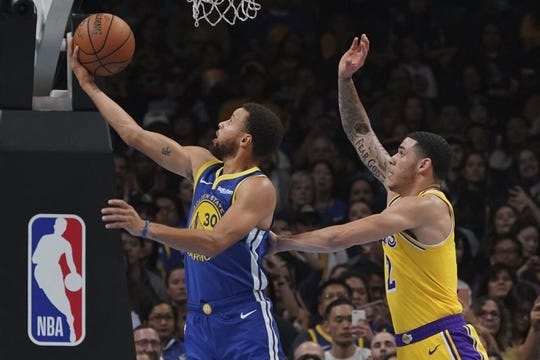October 12, 2018; San Jose, CA, USA; Golden State Warriors guard Stephen Curry (30) shoots the basketball against Los Angeles Lakers guard Lonzo Ball (2) during the first quarter at SAP Center. Mandatory Credit: Kyle Terada-USA TODAY Sports