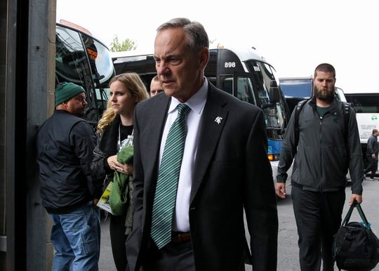 Oct 13, 2018; University Park, PA, USA; Michigan State Spartans head coach Mark Dantonio exits the team bus prior to the game against the Penn State Nittany Lions at Beaver Stadium. Mandatory Credit: Matthew O'Haren-USA TODAY Sports